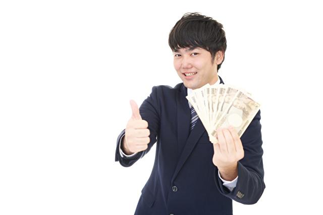 紙幣を持つビジネスマン